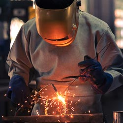 Welder working in Flame Resistant Clothing